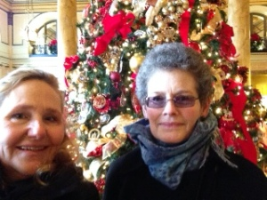 Jane & Joan in front of the tree in the Lobby at the Willard Hotel